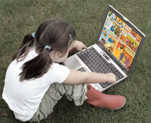 Girl looking at Illustrated Bible on laptop