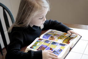 Girl reading Illustrated Bible