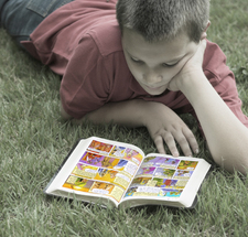 Boy reading Illustrated Bible